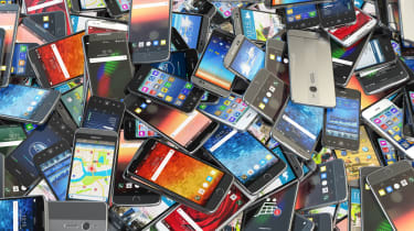 An image of a pile of mobile phones all on top of each other