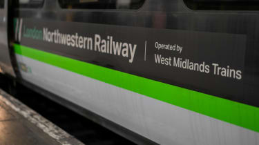 A train operated by the West Midlands Trainline parked in a station
