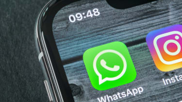 WhatsApp's app in the top corner of a smartphone