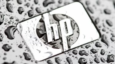 HP logo on a printer with water droplets on it