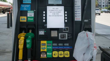 """Fuel pump with an """"out of gas"""" sign on it"""