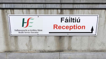 HSE Reception entrance wall sign in English and Irish language