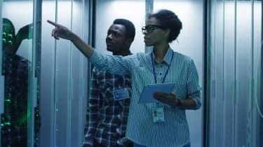 Black woman and Black man in a server room
