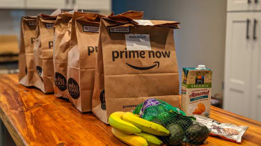 Amazon Prime Now paper grocery bags lined up on a counter