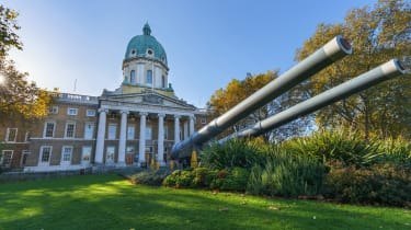 The front entrance of the Imperial War Museum in London with anti-aircraft guns outside