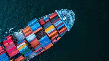 An aerial overhead view of the front half of a container ship