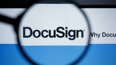 A magnifying glass focusing on the DocuSign logo as seen on its website
