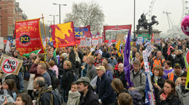 A crowd of protesters holding union banners in London