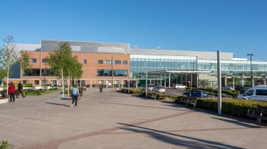 A photo of the front entrance of the Royal Stoke University Hospital, part of the UHNM NHS Trust