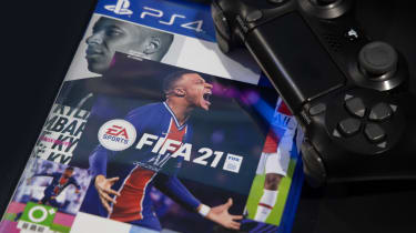 The box of the FIFA 21 title published by EA, with a PS4 controller