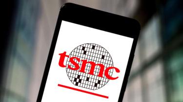 The TSMC logo displayed on a smartphone