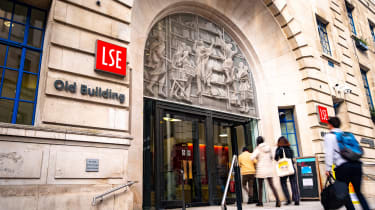Students going through the front door of the main entrance to the LSE's Old Building