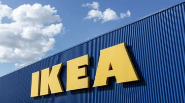 IKEA sign on a wall with cloudy sky in background