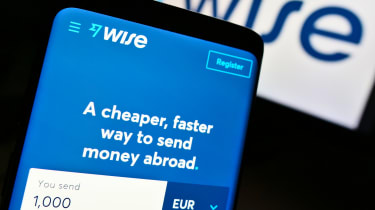 Smartphone with business web page of electronic payment company Wise