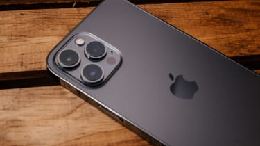iPhone 12 Pro Max phone on a table with the three camera lenses facing up