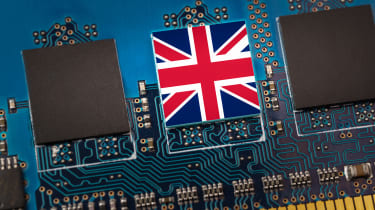 Three computer chips on a circuit board and the middle one has a union flag on it