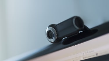 An external webcam on top of a monitor