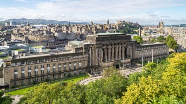 A view over Edinburgh with St Andrew's House, home of the Scottish Parliament, in the foreground