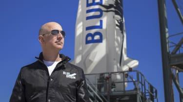 Jeff Bezos standing in front of his Blue Origin rocket