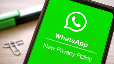 """""""Whatsapp new privacy policy"""" displayed on the green screen of a smartphone"""