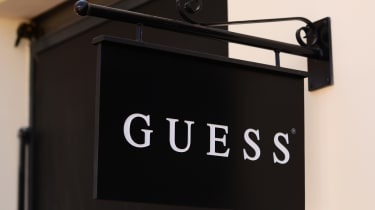 Black and white hanging Guess sign