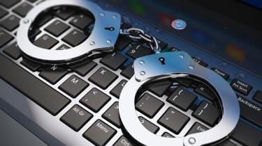 metal handcuffs on laptop keyboard