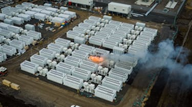 An image of a Tesla battery on fire
