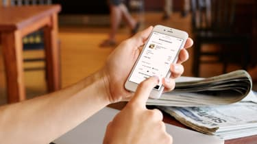 A user navigating to the Square app's checkout page on their mobile phone