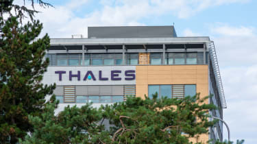 Exterior of an office building with the Thales logo on its side