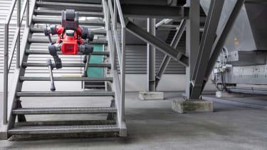 Four-legged robot walking up stairs