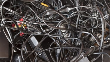 Messy drawer full of wires and cables in a complete disorder