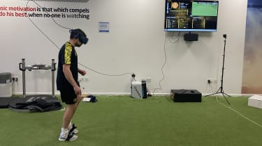 A football player using a VR headset and Rezzil's training software