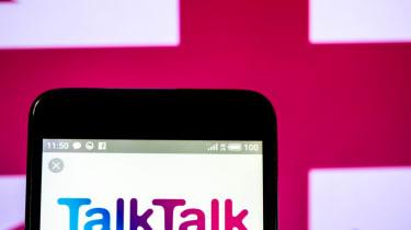 TalkTalk's logo on a smartphone with a UK flag behind
