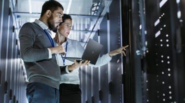 Woman and man looking at servers