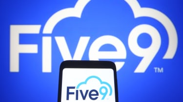 Five9, Inc. logo is seen on a mobile phone and a computer screen.