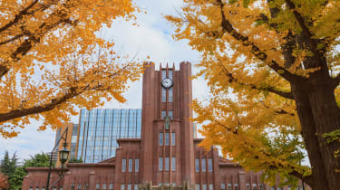 Photo of the Clock Tower building at the University of Tokyo, surrounded by a Ginkgo tree with yellow leaves
