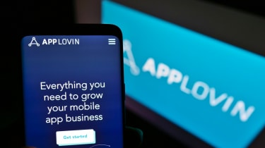 Mobile phone with website of US mobile technology company AppLovin Corp. on screen with logo