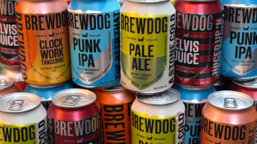 Different types of BrewDog beer cans stacked in a pile