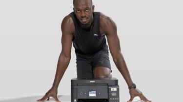 Usain Bolt posing behind an Epson printer