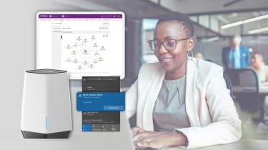 Woman on a computer with NETGEAR's new VPN overlaying the image