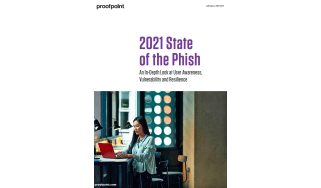 2021 state of the phish - whitepaper from Proofpoint - a woman sits at her computer in an office