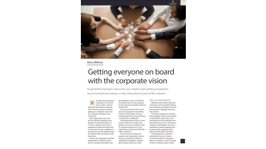 People around a table putting their hands on puzzle pieces - The Business Briefing