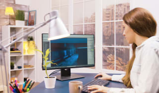 A woman working from home in front of a monitor