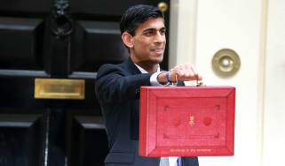 Chancellor of the Exchequer Rishi Sunak holding the red budget box outside 10 Downing Street