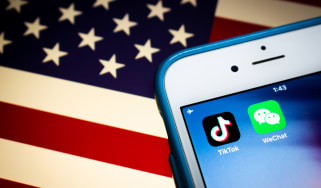 WeChat and TikTok logos with American flag background