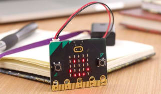 The new BBC Micro:bit displayed in front of a notebook and pen