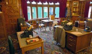 A look inside the Bletchley Park museum that shows desks and code-breaking machines