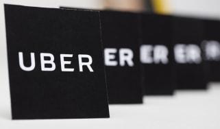Black cards of Uber logos
