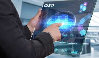 A businessman working on a futuristic tablet that is displaying the word 'CISO'