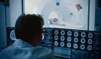 Doctor looking at medical images on a screen
